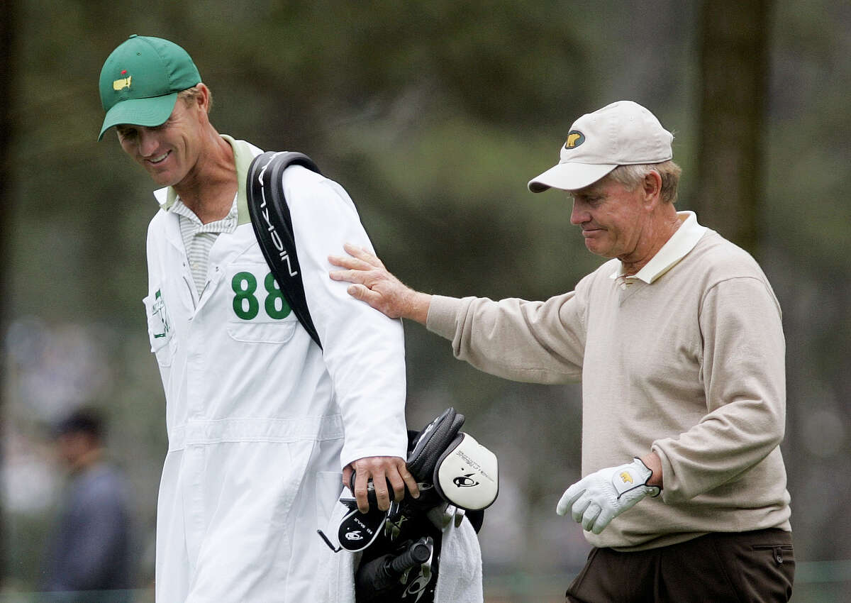 In this 2005 file photo, Jack Nicklaus, right, walks with his son and caddie, Jack Nicklaus II, on the ninth hole during second round of the Masters.