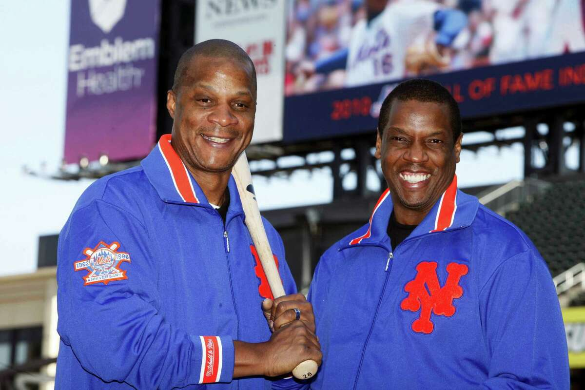 This file photo shows former New York Mets' players Dwight Gooden, right, and Darryl Strawberry posing at Citi Field.