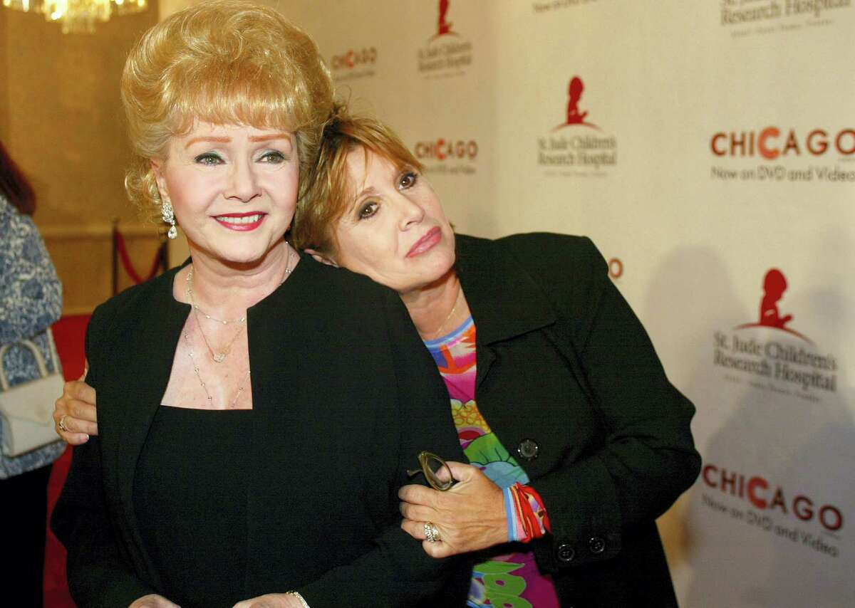 """In this 2003 photo, Debbie Reynolds and Carrie Fisher arrive at the """"Runway for Life"""" Celebrity Fashion Show Benefitting St. Jude's Children's Research Hospital and celebrating the DVD release of Chicago in Beverly Hills, Calif."""
