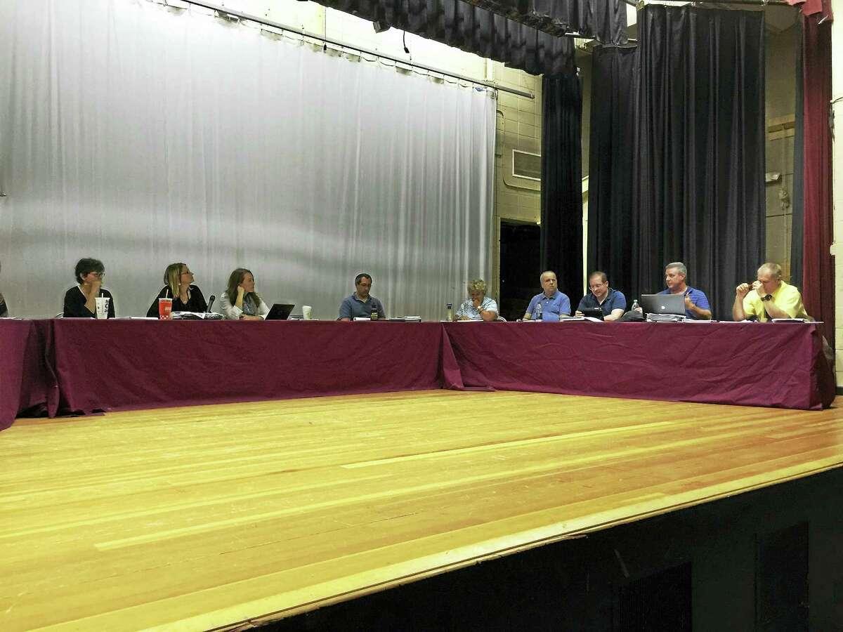 Ben Lambert - The Register Citizen The Torrington Board of Education deliberates Wednesday.