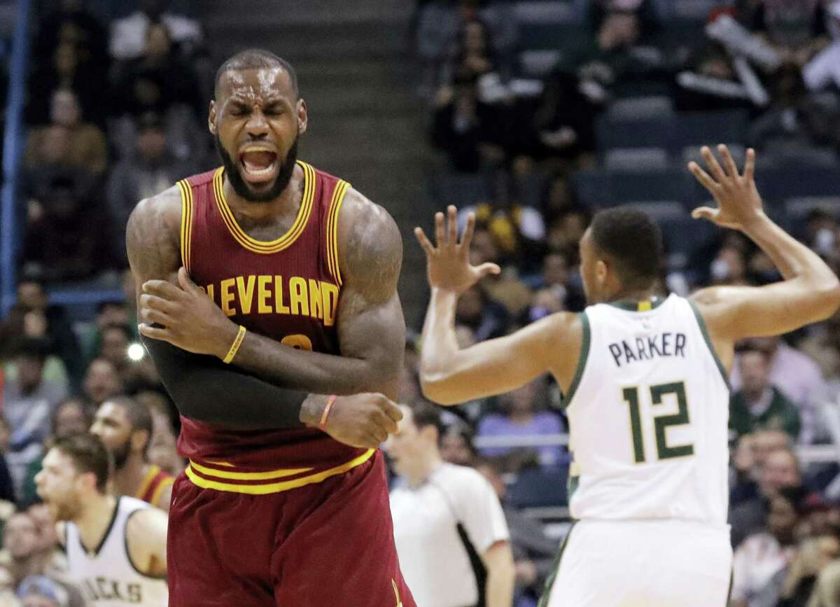 In this file photo, Cleveland Cavaliers' LeBron James reacts to no call being called on his shot during the second half of an NBA basketball game against the Milwaukee Bucks in Milwaukee. On Tuesday, Dec. 27, James, who ended 52 years of sports heartache by bringing Cleveland a championship and used his superstar platform to address social causes, was chosen as The Associated Press 2016 Male Athlete of the Year.