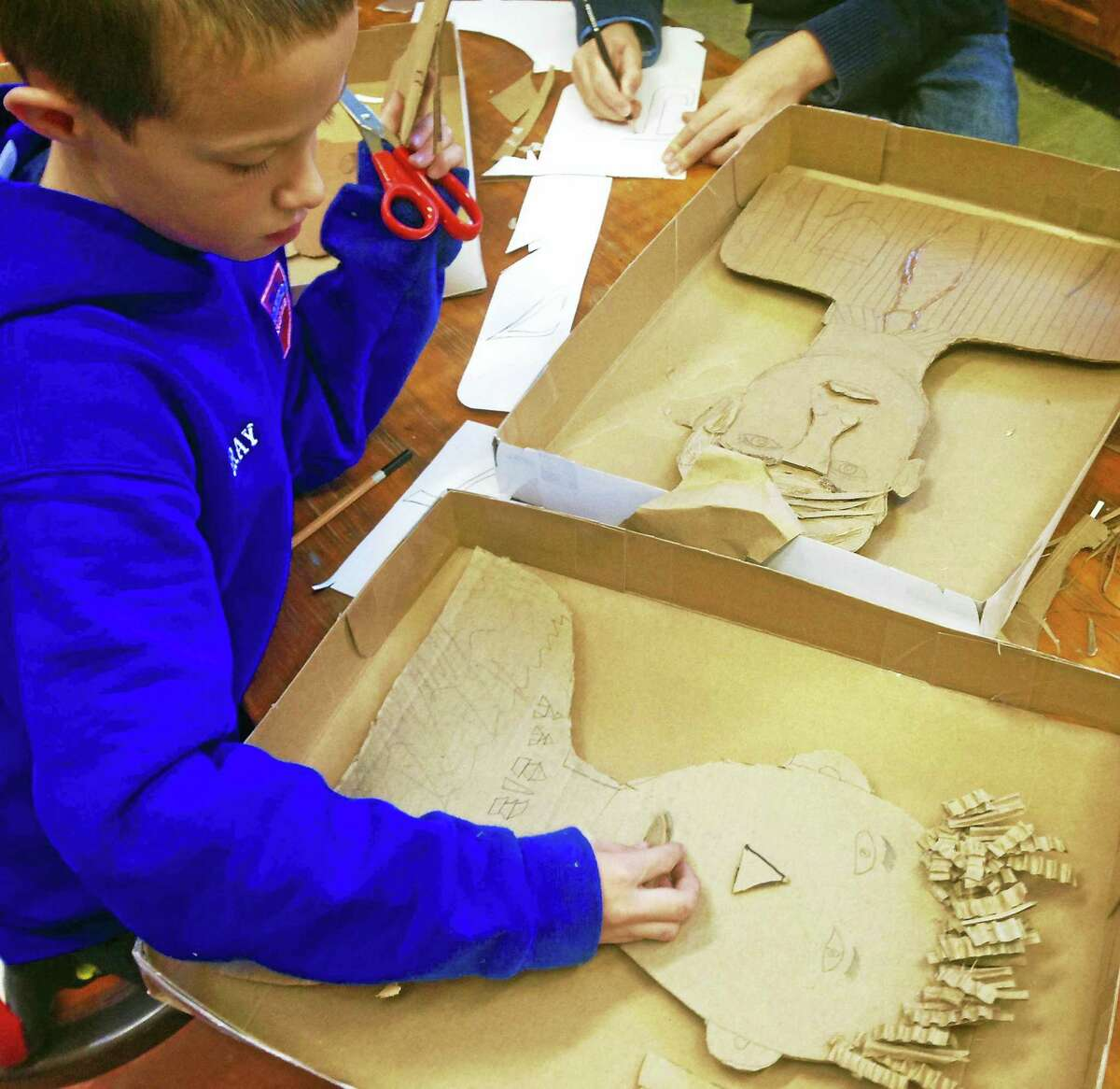 Contributed photosStudents use discarded cardboard to create art for their show at the Oliver Wolcott Library Gallery.