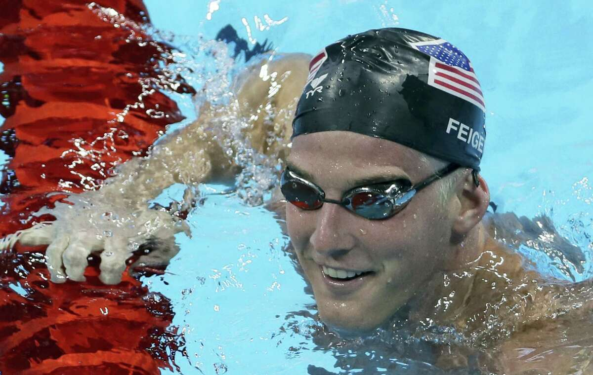In this Aug. 2, 2016 photo, United States James Feigen smiles during a swimming training session prior to the 2016 Summer Olympics in Rio de Janeiro, Brazil. Feigen was one of four American Olympic swimmers in connection to a story of being held at gunpoint and robbed several hours after the last Olympic swimming races ended.