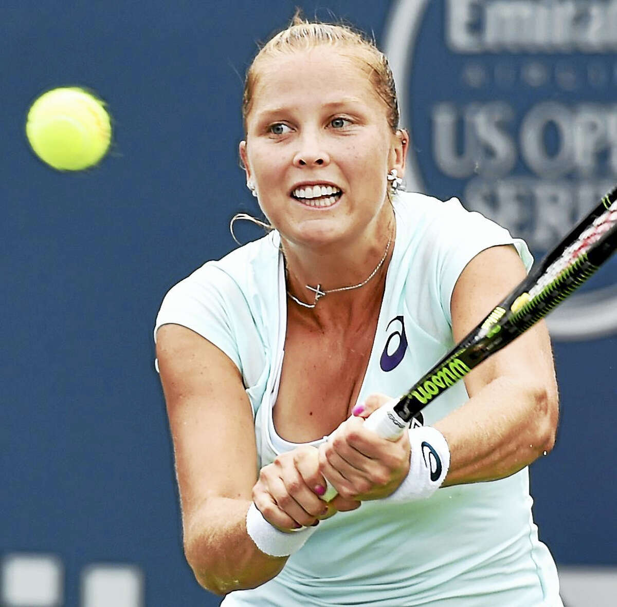 Shelby Rogers returns a shot during her match against Kristina Mladenovic of France at the Connecticut Open on Sunday.