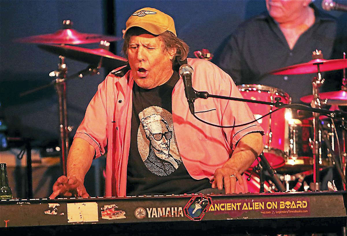 "Photo by John AtashianKeyboardist and singer George Frayne IV, alias Commander Cody, is shown performing on stage with his Lost Planet Airmen. Commander Cody is has been making music since 1967 and is most famous for his big hit, ""Hot Rod Lincoln""."