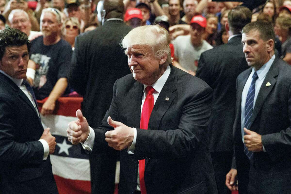 In this Aug. 12, 2016 photo, Republican presidential candidate Donald Trump gives a thumbs up as he leaves a campaign rally in Altoona, Pa. While Donald Trump's chief economic pitch is decrying foreign trade, the audience for his argument is shrinking by the day in the state most pivotal to his shot at the presidency.