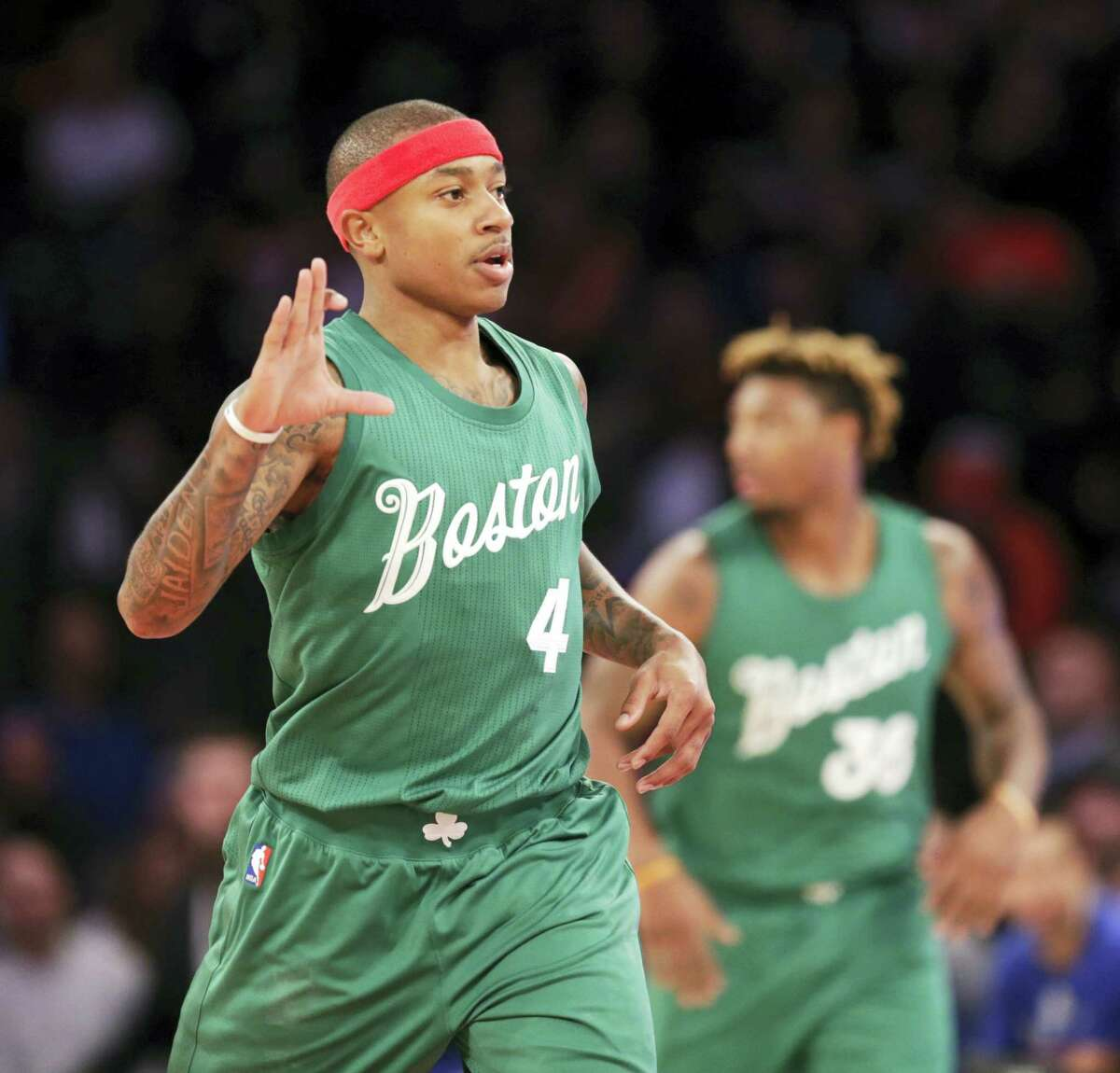 Boston Celtics' Isaiah Thomas reacts after sinking a three-point basket during the first half of the NBA basketball game against the Boston Celtics, Sunday, Dec. 25, 2016 in New York. (AP Photo/Seth Wenig)