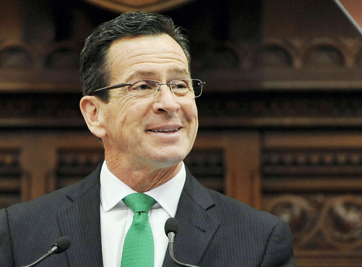 In this Jan. 7, 2015 photo, Connecticut Gov. Dannel P. Malloy smiles during the State of the State address to a joint session of the legislature in the House Chambers at the Capitol in Hartford, Conn. Malloy was named on April 4, 2016, as recipient of the annual John F. Kennedy Profile in Courage Award for supporting the resettlement of Syrian refugees in the U.S. following the November 2015 Paris terrorist attacks. He is scheduled to receive the award in Boston on May 1.