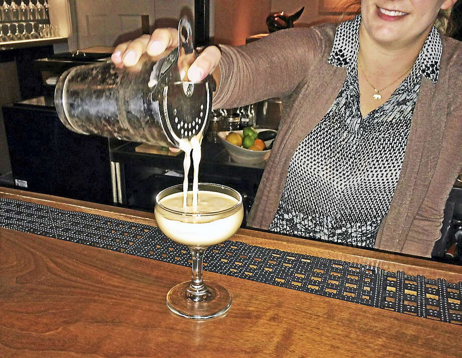 Jamie Monahan pours one of her signature drinks. Photo: Catherine Guarnieri — The Register Citizen