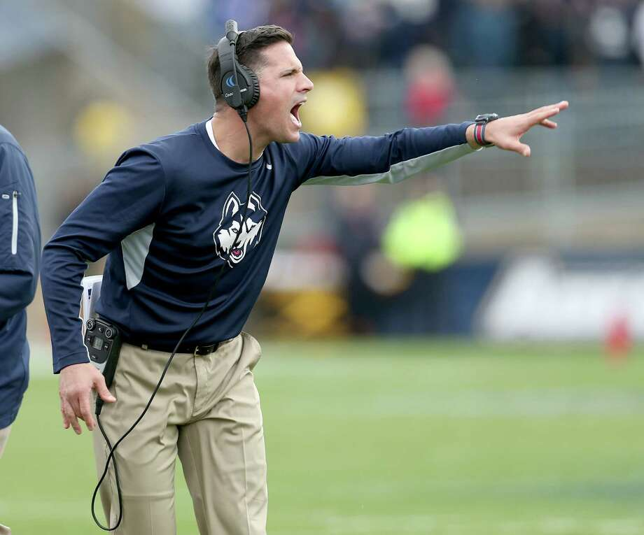 UConn head football coach Bob Diaco yells to his team during the second half of an NCAA college football game against South Florida back in October. UConn is parting ways with Diaco after three seasons. Photo: MARY SCHWALM - THE ASSOCIATED PRESS  / FR158029 AP