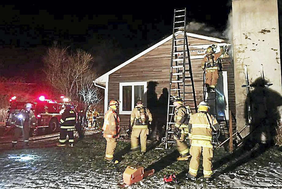 Area firefighters worked to contain a chimney fire that extended into a home Sunday night at 132 Mountain Road. The fire was mostly knocked down within an hour.