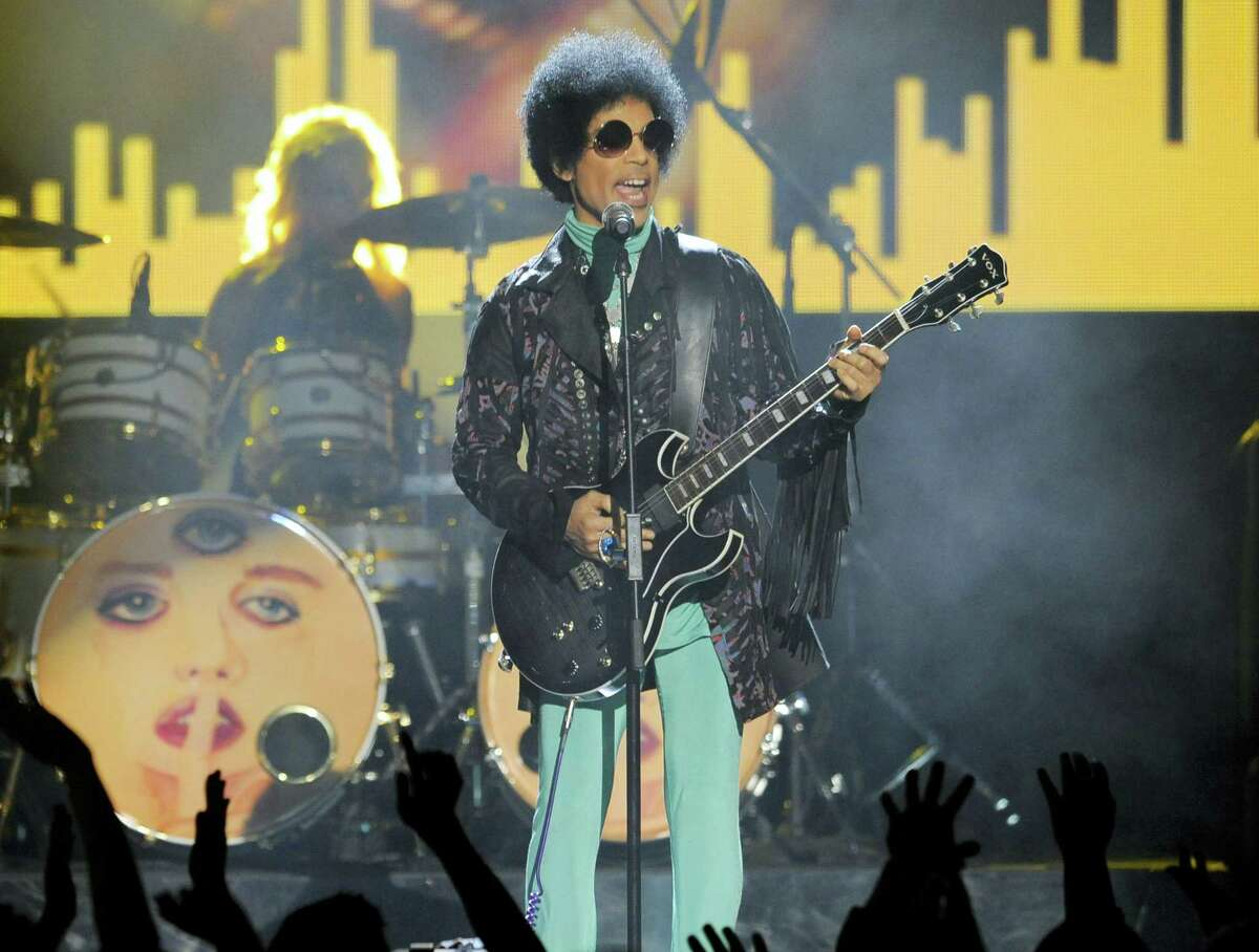 In this May 19, 2013 photo, Prince performs at the Billboard Music Awards at the MGM Grand Garden Arena in Las Vegas. Several pills taken from Prince's estate in Paisley Park after his death were counterfeit drugs that actually contained fentanyl,a synthetic opioid 50 times more powerful than heroin, an official close to the investigation said Sunday, Aug. 21, 2016.