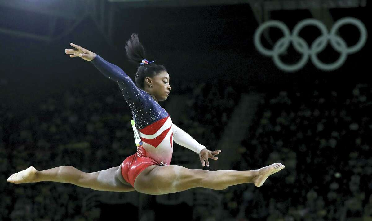 In this Aug. 9 file photo, Simone Biles performs on the balance beam during the artistic gymnastics women's team final at the Summer Olympics in Rio de Janeiro, Brazil. Briles was selected as the AP Female Athlete of the Year.