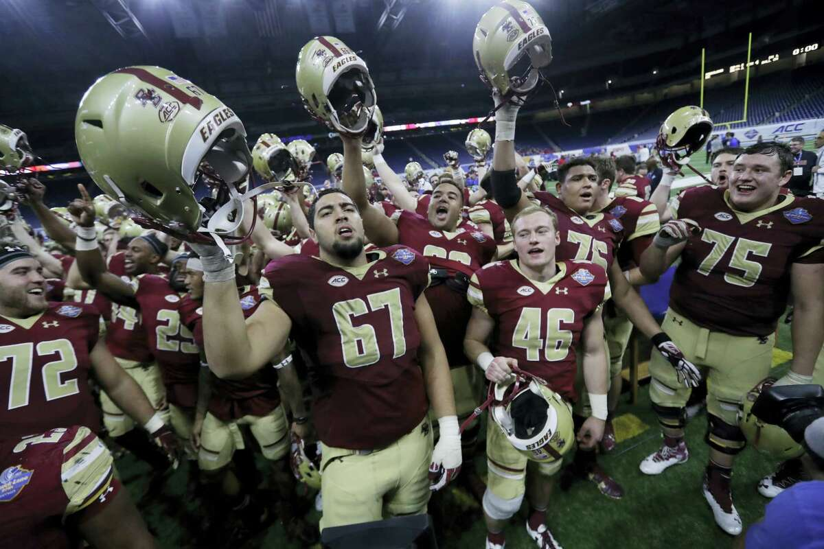 Members of the Boston College team sing after the Quick Lane Bowl Monday in Detroit. Boston College defeated Maryland 36-30.