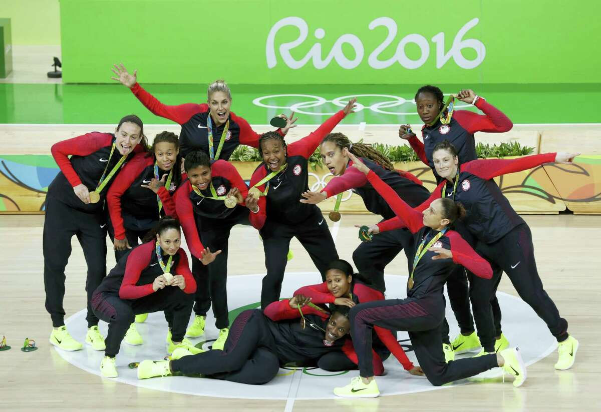Members of the US women's basketball team pose for a photo after winning the gold medal on Saturday.
