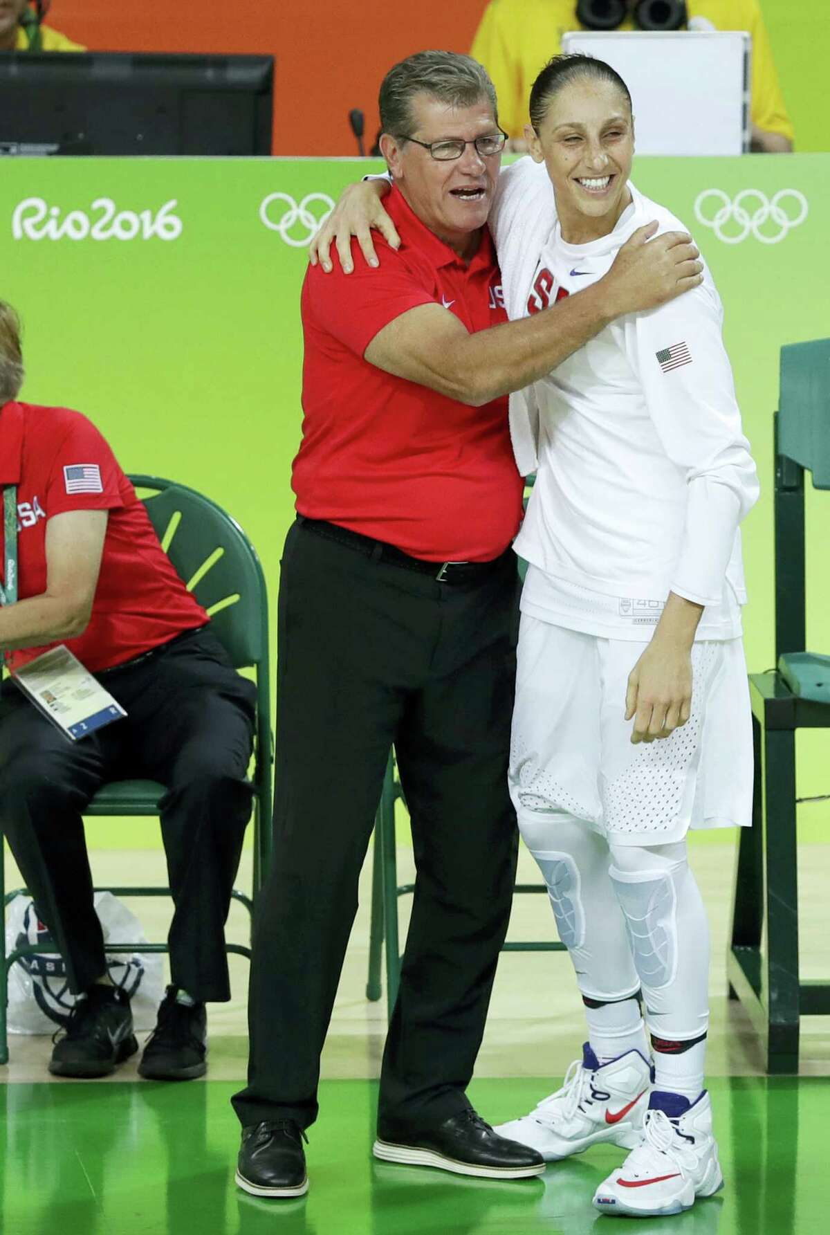 Diana Taurasi, right, celebrates with head coach Geno Auriemma.