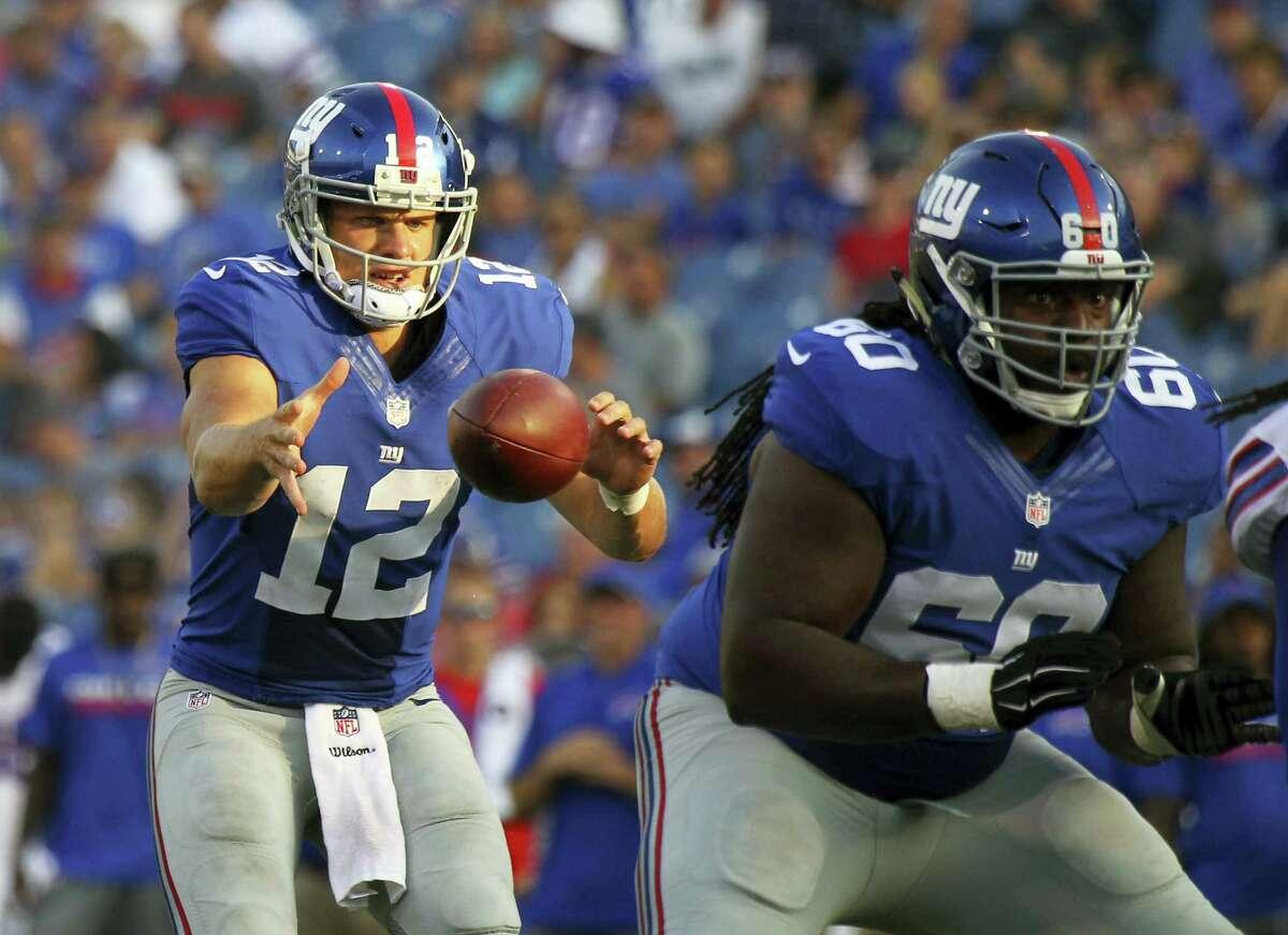 Giants quarterback Ryan Nassib (12) takes the snap during the fourth quarter on Saturday.