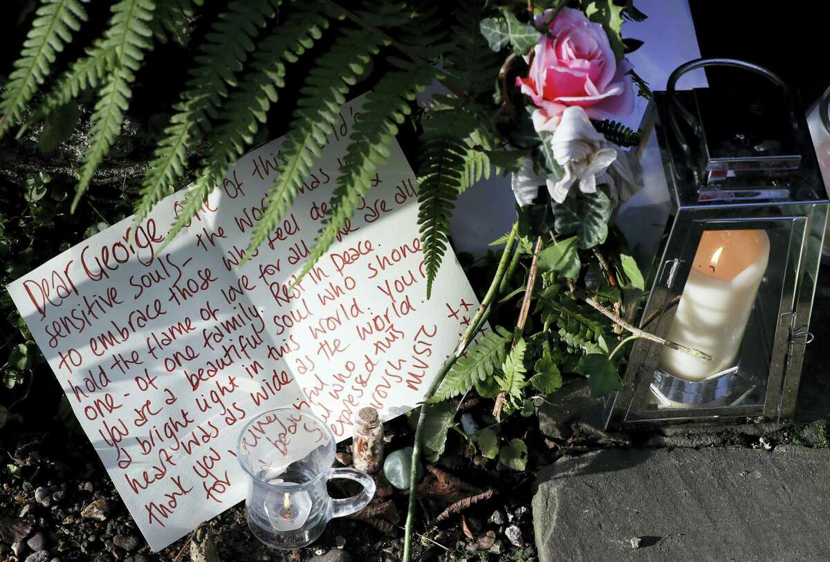 Tributes left outside the home of British musician George Michael in London, Monday. George Michael, who rocketed to stardom with WHAM! and went on to enjoy a long and celebrated solo career lined with controversies, has died, his publicist said Sunday. He was 53.