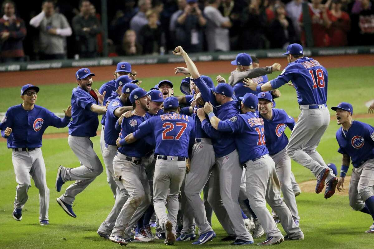 Chicago Cubs celebrate after Game 7 of the Major League Baseball World Series against the Cleveland Indians Thursday, Nov. 3, 2016 in Cleveland. The Cubs won 8-7 in 10 innings to win the series 4-3.
