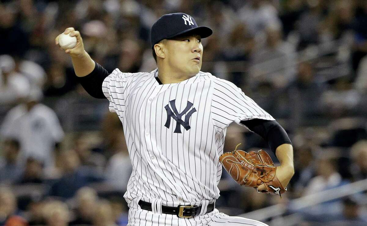 FILE - In this Tuesday, Oct. 6, 2015, file photo, New York Yankees pitcher Masahiro Tanaka delivers against the Houston Astros during the first inning of the American League wild card baseball game in New York. When Dallas Keuchel last took the mound at Yankee Stadium, he pitched six scoreless innings on short rest to lead the Houston Astros over New York and ace Tanaka in the AL wild card game. (AP Photo/Julie Jacobson, File)