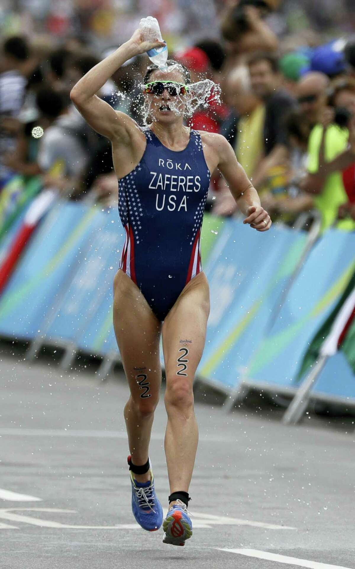 Katie Zaferes of the United States douses herself with water during the women's triathlon competition of the 2016 Summer Olympics in Rio de Janeiro, Brazil, Saturday, Aug. 20, 2016.