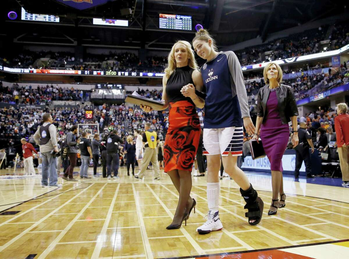 UConn's Katie Lou Samuelson (33) leaves the court with assistant coach Shea Ralph Sunday.