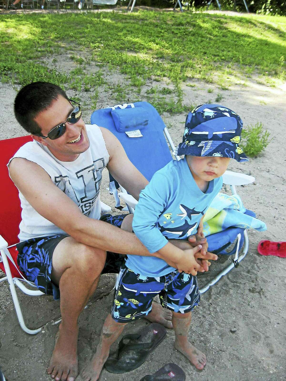 E.J. Yerzak and his son, Brady, at Morris Town Beach.