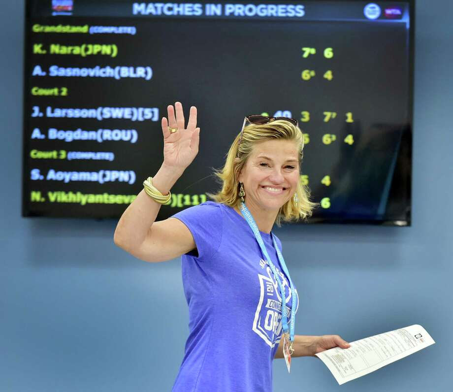 Connecticut Open tournament director Anne Worcester waves in the Media Center at the Connecticut Open tennis tournament in New Haven, Conn. on Saturday, August 19, 2017. Photo: Peter Hvizdak / Hearst Connecticut Media / New Haven Register
