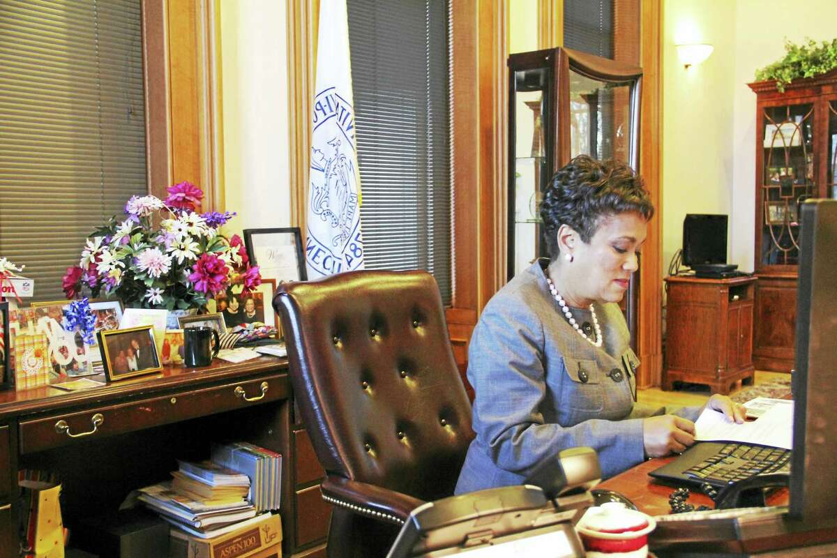 New Haven Mayor Toni Harp at her desk on Thursday, Dec. 8, at her office at City Hall. Harp has vowed to keep the New Haven a sanctuary city amid President-elect Donald Trump's promise to stop funding to such cities.