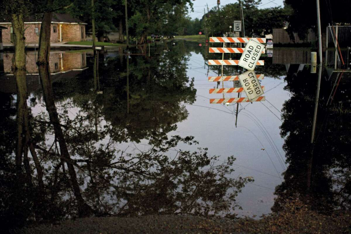 Standing water closes roads in Sorrento, La., Saturday, Aug. 20, 2016. Louisiana continues to dig itself out from devastating floods, with search parties going door to door looking for survivors or bodies trapped by flooding.