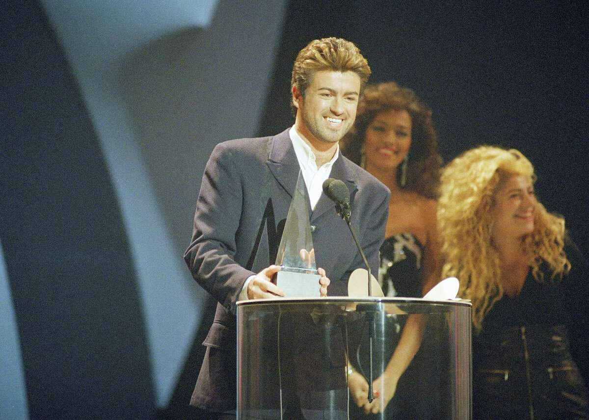 FILE - In this Monday, Jan. 31, 1989 file photo, George Michael accepts one of his three American Music Awards during ceremonies in Los Angeles. Michael, who rocketed to stardom with WHAM! and went on to enjoy a long and celebrated solo career lined with controversies, has died, his publicist said Sunday, Dec. 25, 2016. He was 53. (AP Photo/Alan Greth)