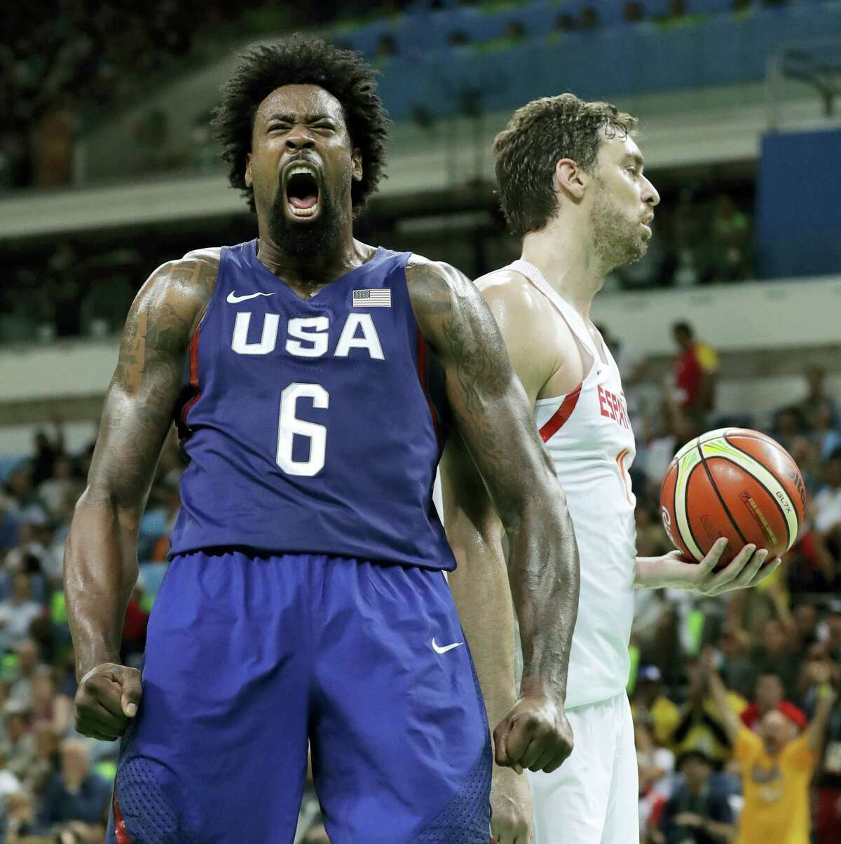 DeAndre Jordan celebrates in front of Spain's Pau Gasol, right, after dunking during Friday's semifinal in Rio.