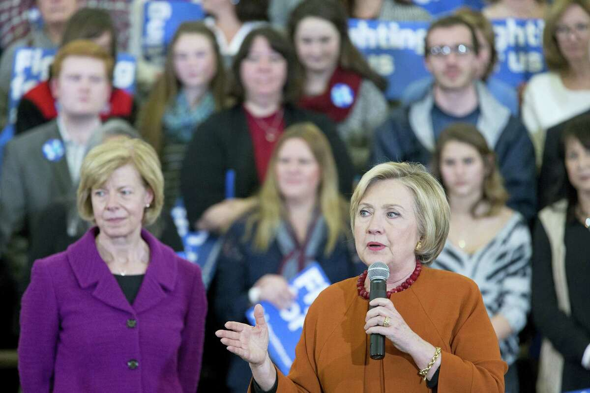 Democratic presidential candidate Hillary Clinton, right, is joined by Sen. Tammy Baldwin, D-WI, at a campaign event on Saturday, April 2, 2016 in Eau Claire, Wis.