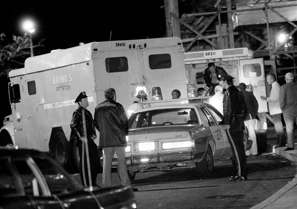 In this Oct. 21, 1981 photo, police are at the scene of a Brinks armored truck robbery at the Nanuet Mall in Nanuet, N.Y., where multiple Nyack police officers and a Brinks guard were killed earlier during the robbery. After more than 30 years behind bars Mutulu Shakur, accused of running a revolutionary group that authorities said was responsible for a series of armed robberies, including the Brink's heist, may soon walk free.