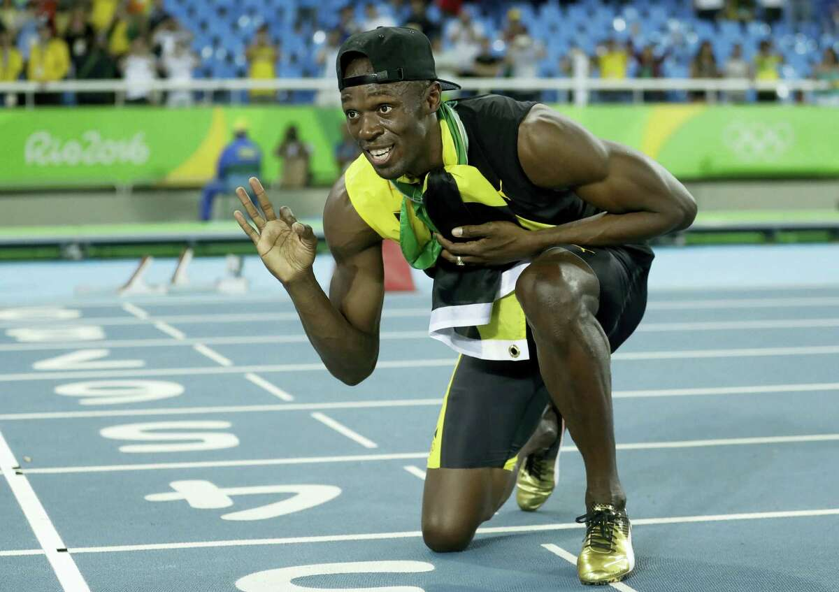 Jamaica's Usain Bolt celebrates winning the gold medal in the men's 4x100-meter relay final on Friday.