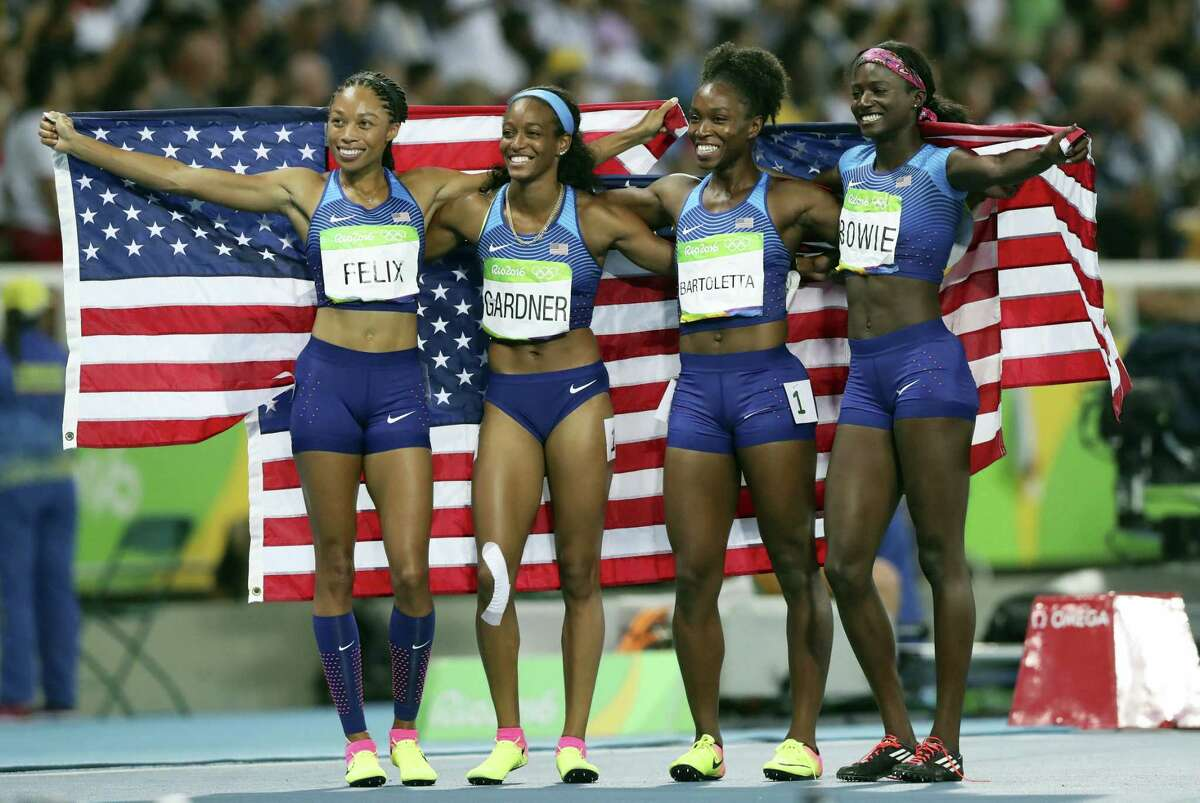 The United States 4x100-relay team, from left, Allyson Felix, English Gardner, Tianna Bartoletta and Tori Bowie celebrate winning the gold on Friday.