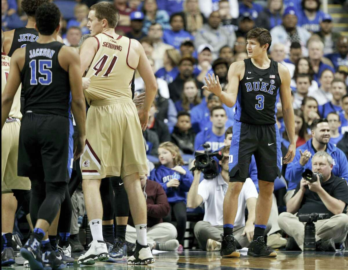 Duke's Grayson Allen, right, reacts after being called for a foul for tripping an Elon player on Wednesday.
