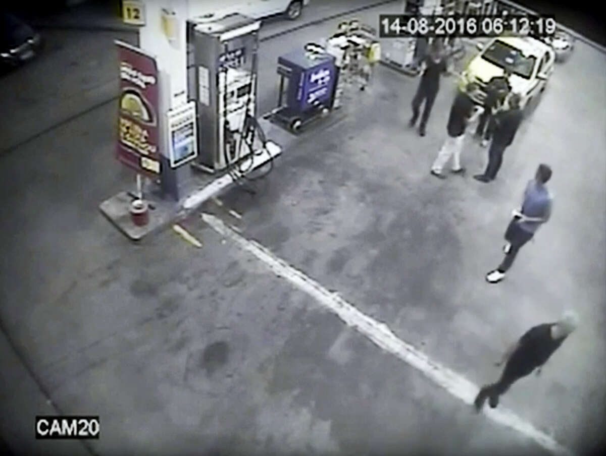 In thisSunday, Aug. 14, 2016, frame from surveillance video released byBrazil police, swimmers from the US Olympic team appear with Ryan Lochte, right, at a gasstation during the 2016 Summer Olympics in Rio de Janeiro, Brazil. A top Brazil police official said the swimmers damaged property at the gas station.