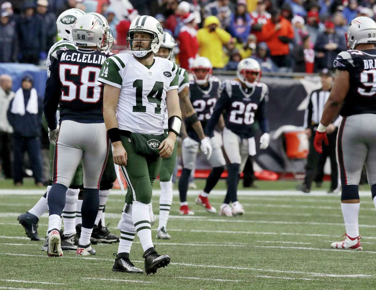Jets quarterback Ryan Fitzpatrick looks at the scoreboard after failing to make a first down.