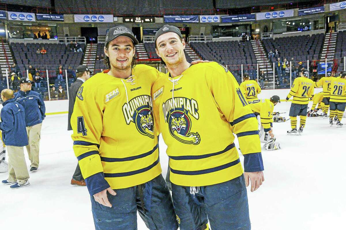 Quinnipiac junior defenseman Connor Clifton, left, and junior forward Tim Clifton pose for a photo after last week's NCAA tournament win over UMass Lowell.