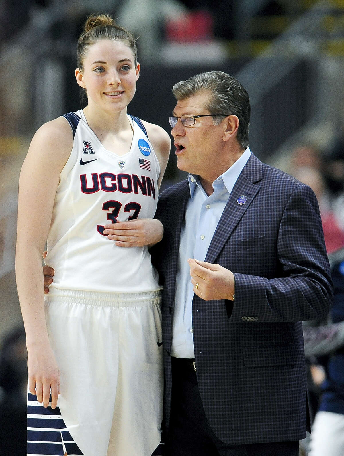 UConn coach Geno Auriemma, right, instructs Katie Lou Samuelson during the regional semifinals.
