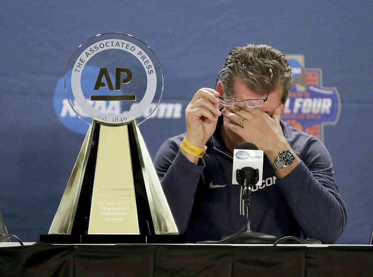 UConn coach Geno Auriemma wipes his eyes after being named the Associated Press Coach of the Year on Saturday.