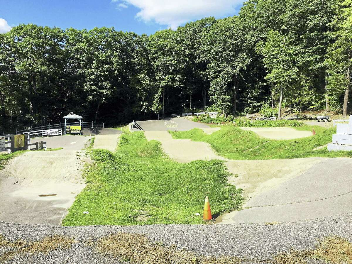Ben Lambert - The Register Citizen Alvord Park's BMX track is used on Sundays. The City Council approved a plan for a disc golf project on the property.