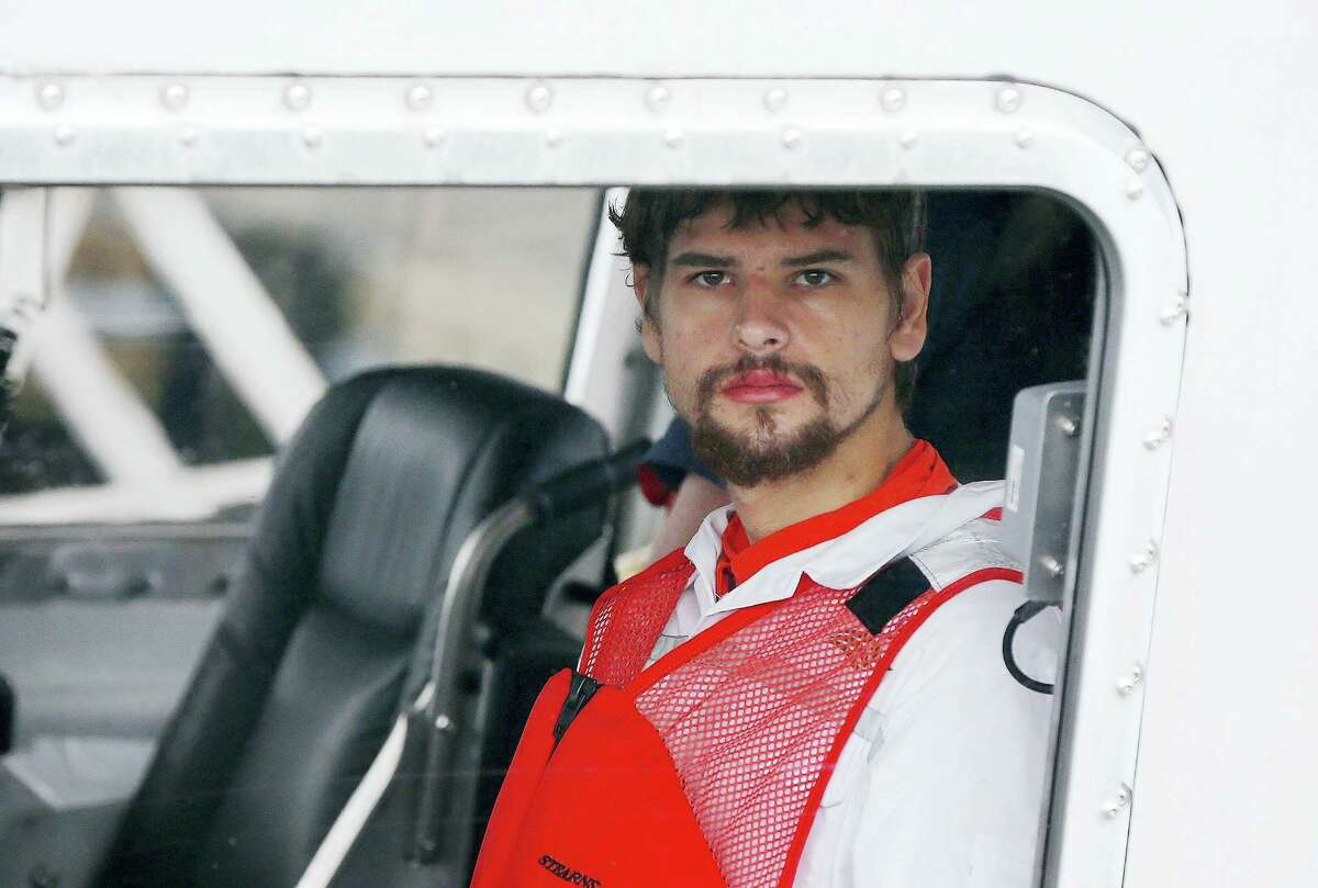 In this file photo, Nathan Carman arrives in a small boat at the U.S. Coast Guard station in Boston after spending a week at sea in a life raft before being rescued by a passing freighter. His mother who accompanied him on the ill-fated fishing trip was missing and presumed dead.