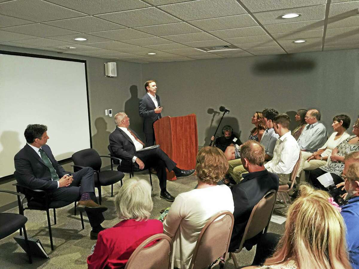 Ben Lambert - The Register CitizenU.S. Sen. Chris Murphy, standing, speaks to a group of students and residents during a forum on the Second Amendment and gun control at the American Museum of Tort Law in Winsted.