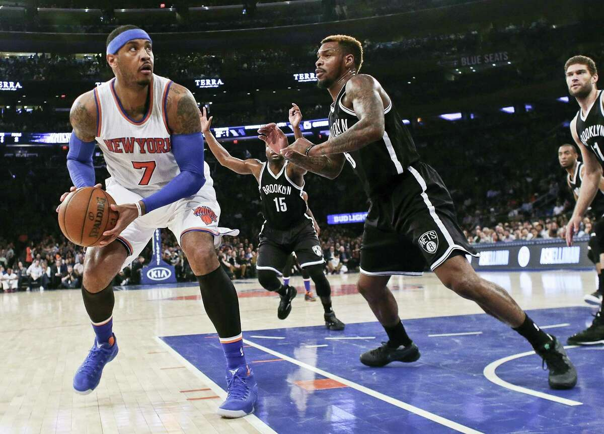 The Knicks' Carmelo Anthony (7) looks for a shot as the Nets' Sean Kilpatrick defends during the first half on Friday.