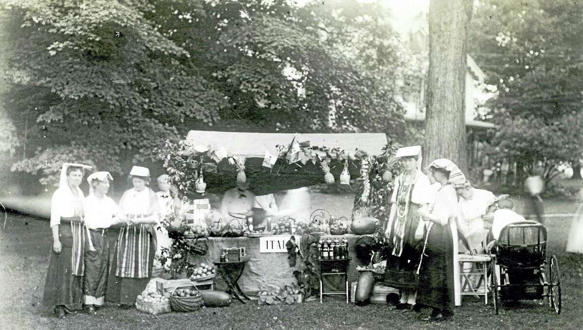 Photo courtesy of Gunn Historical Society The Italy Booth at Sister Susies Allied Market on the Washington Green, Aug. 1916. The market will be celebrated on the green with activities and events on Sunday, Aug. 28.