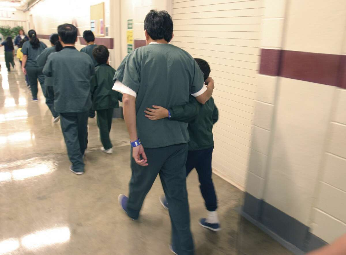 A Feb. 9, 2007 photo provided by the Department of Homeland Security shows family detainees walking down the hall at the T. Don Hutto Residential Center in Taylor, Texas.