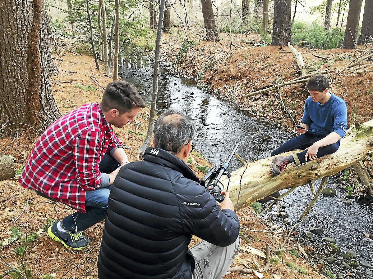 Writer/director Matt Newton, director of photography Douglas Keeve and lead actor Bryan Manley Davis in the Guilford woods.