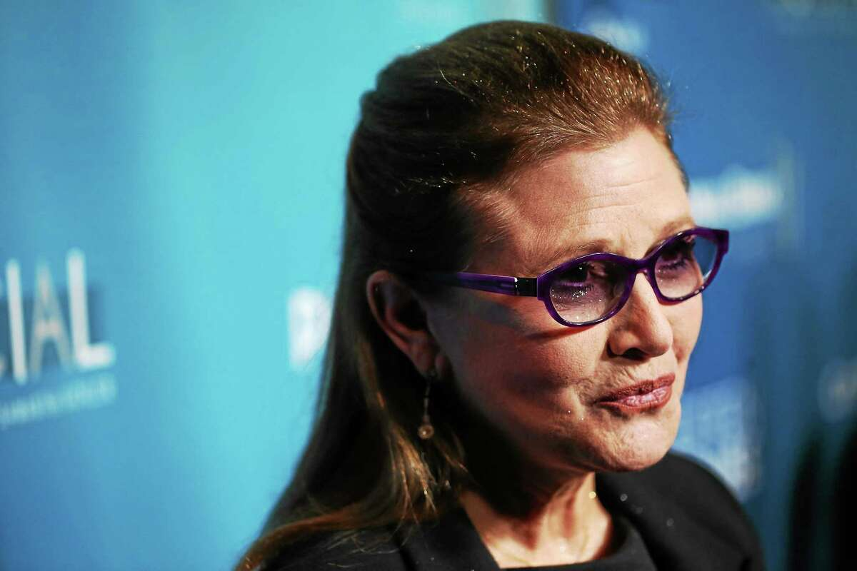 Carrie Fisher arrives at Backstage At The Geffen Gala on Saturday, March 22, 2014, in Los Angeles.
